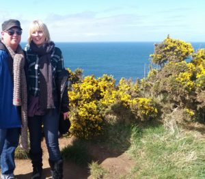 A recent walk together (with gorse/furze bush in the background).
